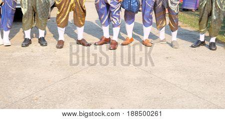 Close up foot Asian man wearing national dress Thailand Groomsman
