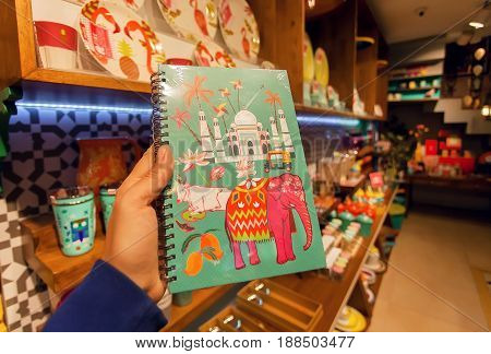 BANGALORE, INDIA - FEB 14, 2017: Indian symbols - Taj Mahal cow and elephant on cover of notebook in souvenir store on February 14, 2017. With popul. 8.52 million Bangalore is 3rd most populous indian city