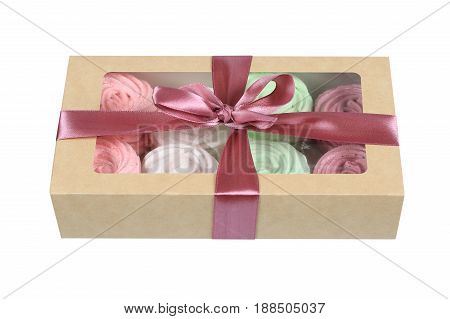 Delicate multicolored homemade zephyr or marshmallow in the box isolated on a white background
