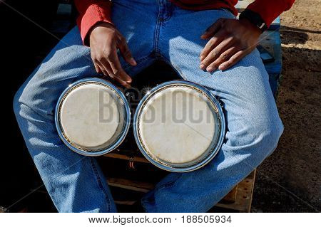 A Man Playing African Drum Djembe