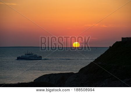 Sunset, Cruiser Boat In Silhouette, Brittany