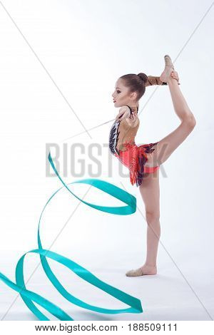 beautiful caucasian girl gymnast with Turquoise ribbon on a white background