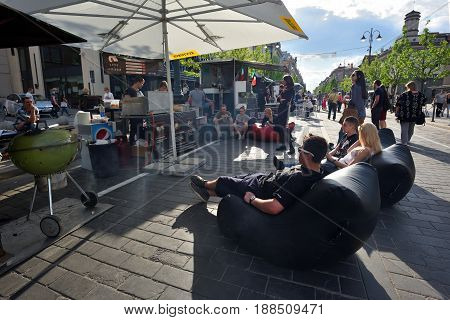 VILNIUS - MAY 20: Unidentified people relaxing in Vilnius Old Town outdoor cafe on May 20 2017 in Vilnius Lithuania. Vilnius is the capital of Lithuania and its largest city.