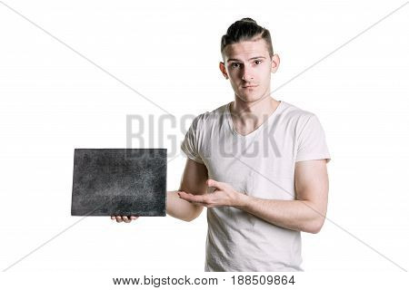 A Young Handsome Guy With An Empty Gray Plaque, Points To A Plaque. Place For Signature, Text. Horiz