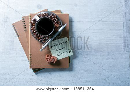 Blank Spiral Notepads, Cup Of Coffee And Pen On Wood Background