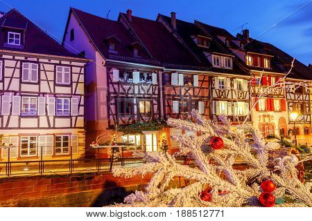 Traditional old half-timbered houses in the historic city of Colmar. Decorated and lighted during the Christmas season. Alsace. France.