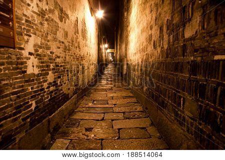 Night shot of walk street narrow brick wall ancient wall of China village park