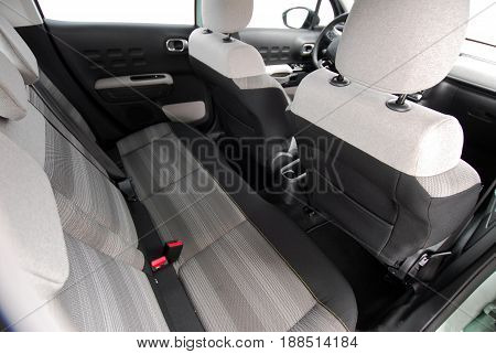 car interior, black leather rear seat in the passenger car