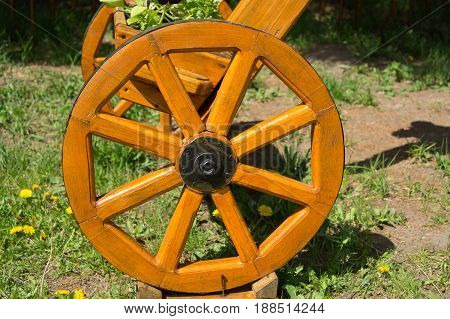 The Wheel Of A Wooden Self-made Bicycle. Art Object In The Garden, Park