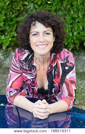 Mid Adult Woman With Curly Hair Smiling