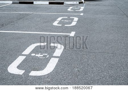 Parking for cars places for the disabled sign on the asphalt