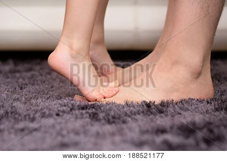 Small Child Standing On Dad's Feet