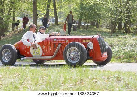 STOCKHOLM SWEDEN - MAY 22 2017: Red Rundbaneracer classic car from 1957 driving on a country road in the public race Gardesloppet in the forests at Djurgarden Stockholm Sweden. May 22 2017
