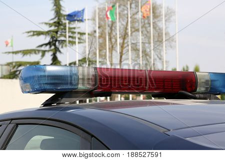 Police Car With European And Italian Flags On Background Outdoor