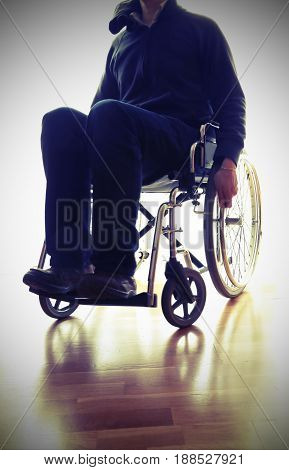 Wheelchair In The Bedroom With Person
