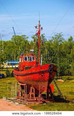 Pilot boat sits in dry dock for repair and maintenance.