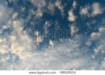 Bright Contrasting Gray Air Clouds In The Blue Sky