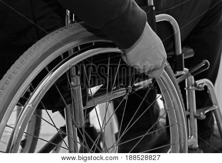 Wheelchair With The Hand Of The Disabled Person On The Wheel