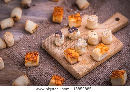 Salty party snack in wooden desk and natural jute.