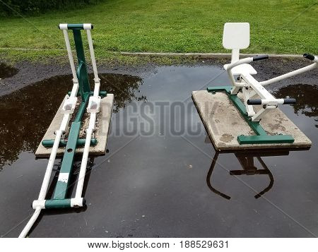 flooded and weathered outdoor pieces of exercice equipment