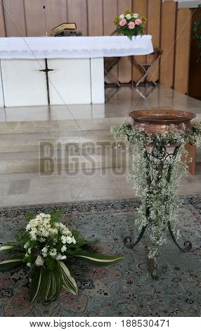 White Altar Of The Christian Church With The Baptismal Font Duri