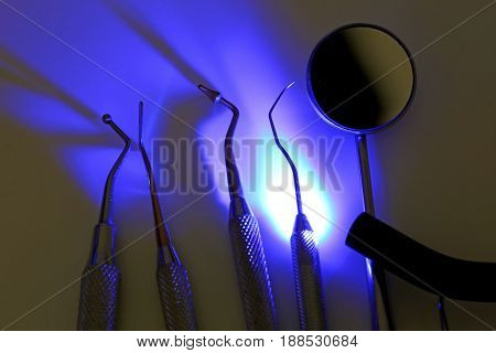 Dental Tools For Tooth Cleaning And Ultraviolet Light For Steril