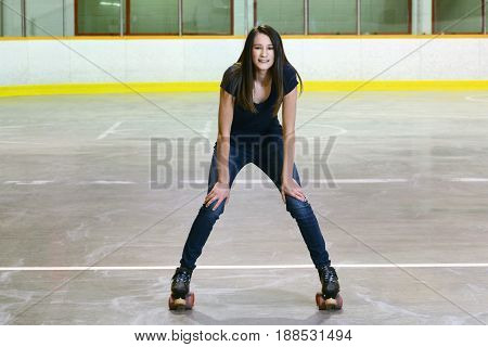 portrait of female teenager in roller skating arena