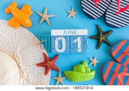 June 1st. Image of june 1 calendar on blue background with summer beach, traveler outfit and accessories. First summer day. Happy Childrens Day.