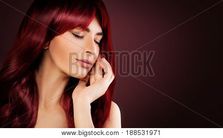 Redhead Woman with Perfect Hairstyle and Makeup. Beautiful Model with Long Healthy Red Hair Relaxing