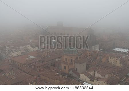 Basilica of San Petronio in a foggy day. View from a window of Asinelli Tower. Emilia Romagna Italy.