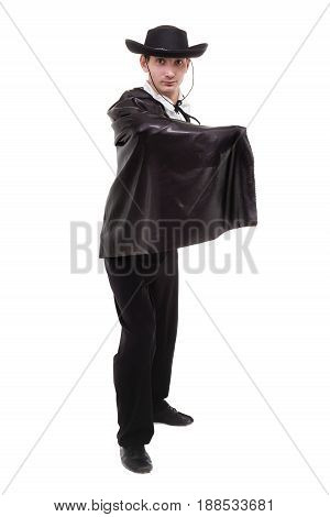 man wearing a zorro costume posing, isolated on white in full length.