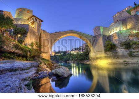 Stari Most, old bridge in Mostar by night, Bosnia and Herzegovina, HDR
