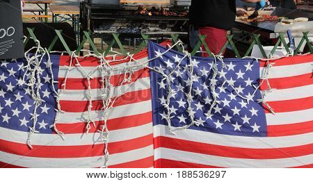 Two American Flags In The Street Food Stall While The Cook Prepa