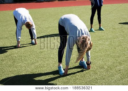 High school girls stetch after track and field practic