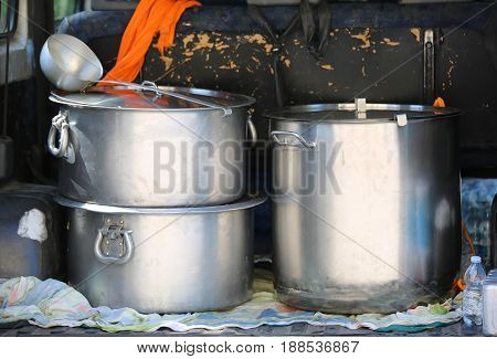 Pans For Transporting Food In A Van Of Non-governmental Organiza