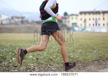 Athlete Runs Fast With Long Strides Towards The Finish Line Duri