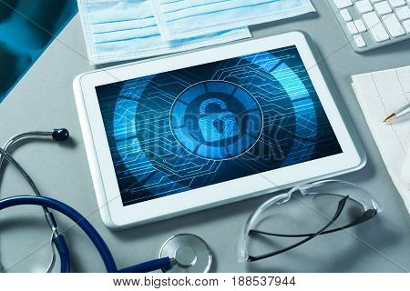 Doctors workplace with white tablet stethoscope and mask