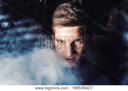 The Guy Smokes, Exhales Smoke. Steam From An Electronic Cigarette