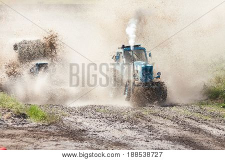 Trucks races on off road terrain. Races without rules on a cross-country terrain. Racing on tractors.