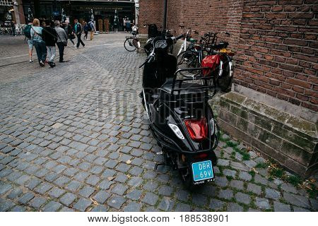 The Hague The Netherlands - August 7 2016: Scooter parked in a street in the Hague city centre. The Hague is the seat of the Dutch government and multiple international organizations.