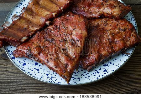 Grilled Pork Ribs On A Wooden Old Board