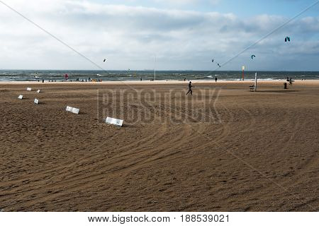 The Hague The Netherlands - August 7 2016: People doing kite surfing a windy day in the beach of The Hague