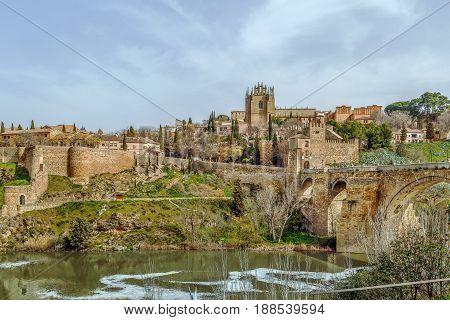 View of Monastery of San Juan de los Reyes (Monastery of Saint John of the Monarchs) from Tagus river Toledo Spain