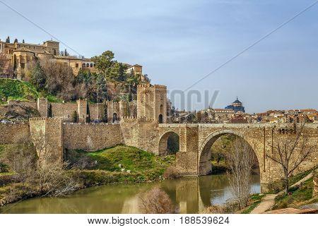 The Puente de Alcantara is a Roman arch bridge in Toledo Spain spanning the Tagus River