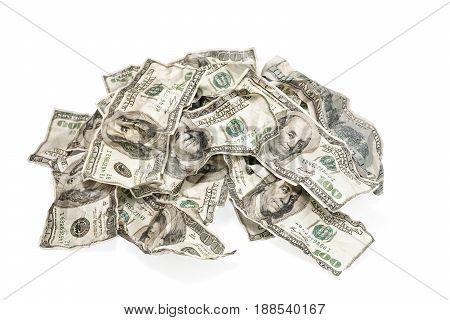 Big pile of rumpled money isolated on white background