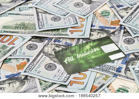Green plastic credit card on paper money close-up