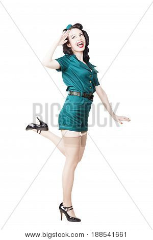 Portrait of Beautiful Brunette with black hair. Pin up Female Dressed in military clothing Uniform and Garrison cap saluting. Army Pin-up Girl Concept