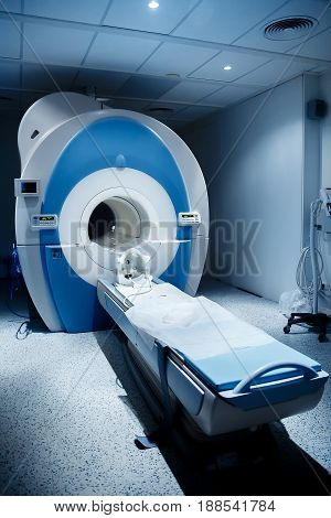 Radiologist in the MRI room, magnetic resonance therapy in the hospital. Concept diagnosis of cancer.