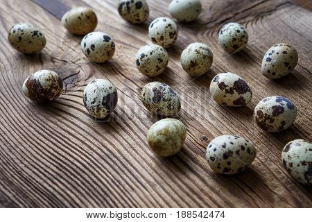 Quail eggs on a old wooden board