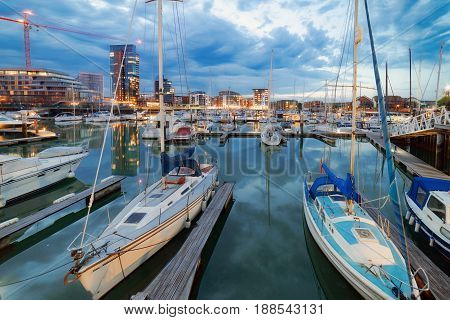 Luxury yachts and boats at twilight in Southampton